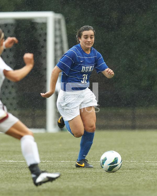 Duke University defender Christina Gibbons (31) brings the ball forward. Boston College (white) defeated Duke University (blue/white), 4-1, at Newton Campus Field, on October 6, 2013.