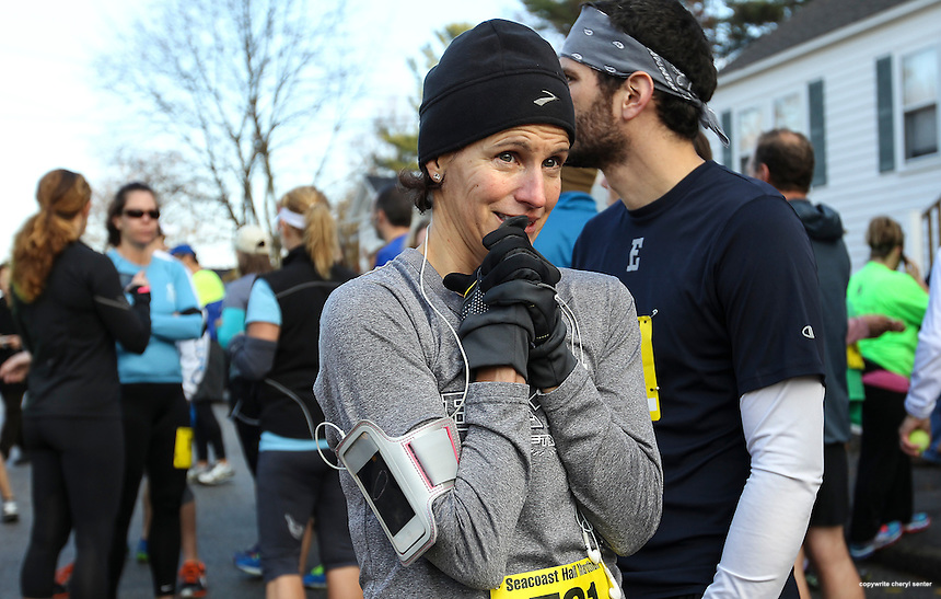 Eileen Roblee of Exeter, facing center, and Mark Tobey of Newfields, right, wait for the start of the annual Seacoast Half Marathon in Portsmouth, N.H., Sunday, Nov. 10, 2013.  (Portsmouth Herald Photo Cheryl Senter)