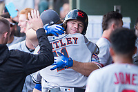 AFL East first baseman Peter Alonso (20), of the Scottsdale Scorpions and the New York Mets organization, receives a hug from starting pitcher Forrest Whitley (11) after hitting a home run in the first inning during the Fall Stars game at Surprise Stadium on November 3, 2018 in Surprise, Arizona. The AFL West defeated the AFL East 7-6 . (Zachary Lucy/Four Seam Images)