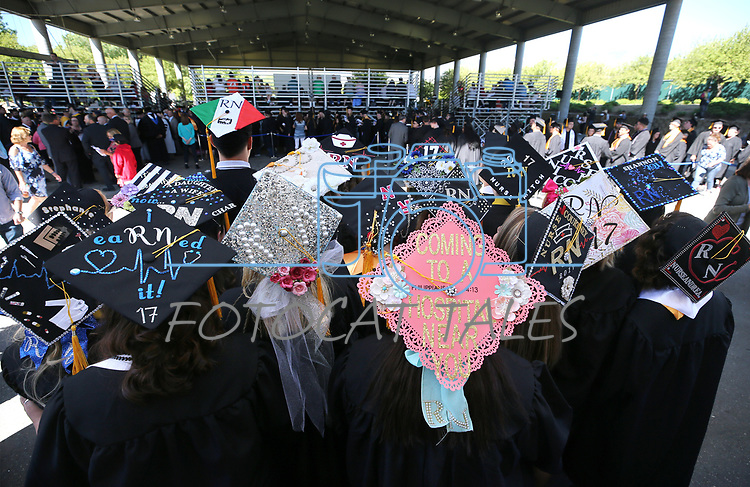 Nursing students show off their decorated caps before the Western Nevada College 2017 Commencement in Carson City, Nev. on Monday, May 22, 2017.  <br />