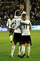 Moussa Dembele (No 9) celebrates scoring Fulham's second goal with Joshua Smile and George Williams
