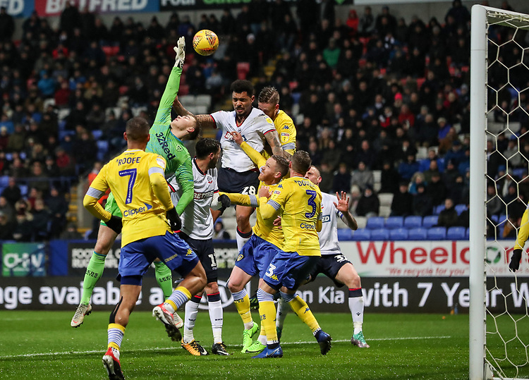 Bolton Wanderers' Josh Magennis competing with Leeds United's goalkeeper Bailey Peacock-Farrell<br /> <br /> Photographer Andrew Kearns/CameraSport<br /> <br /> The EFL Sky Bet Championship - Bolton Wanderers v Leeds United - Saturday 15th December 2018 - University of Bolton Stadium - Bolton<br /> <br /> World Copyright © 2018 CameraSport. All rights reserved. 43 Linden Ave. Countesthorpe. Leicester. England. LE8 5PG - Tel: +44 (0) 116 277 4147 - admin@camerasport.com - www.camerasport.com