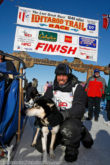 Friday March 16, 2007  - Nome, Alaska ----  Tom Lesatz poses with his lead dog at the finish chute on Front street.