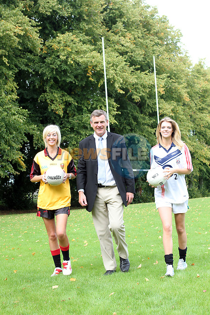 Donna McDowell (Down Jersey) and Sarah Taylor (Cork Jersey) with Colm O'Rourke...Picture Jenny Matthews/Newsfile.ie