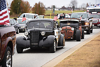 NWA Democrat-Gazette/FLIP PUTTHOFF<br /> PARADE READY<br /> Vintage automobiles roll down Dixieland Road on Saturday Nov. 11 2017 during the Lowell Veterans Day parade. The group, Remember Everyone Deployed, or Red Friday, organized the parade. Red Friday provides support for veterans from the time start basic training into retirement, said Mike Whitehead with Red Friday. Rogers High School Marching Band, military, police and firefighting vehicles and veterans were part of the Saturday morning parade.