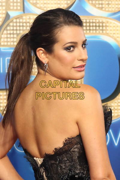 LEA MICHELE.The 20th Century Fox 'Glee 3D' Concert World Movie Premiere held at The Regency Village theatre in Westwood, California, USA,.August 6th 2011..half length looking over shoulder back behind rear ponytail dress strapless black hair up .CAP/CEL.©CEL/Capital Pictures