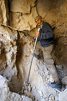 A miner digging by hand in a hunt of Emeralds at 4000 meters high, in the Panshir valley.