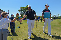 Shane Lowry (IRL) high fives a young fan as he and Padraig Harrington (IRL) head to 18 during Round 1 of the Zurich Classic of New Orl, TPC Louisiana, Avondale, Louisiana, USA. 4/26/2018.<br /> Picture: Golffile | Ken Murray<br /> <br /> <br /> All photo usage must carry mandatory copyright credit (&copy; Golffile | Ken Murray)