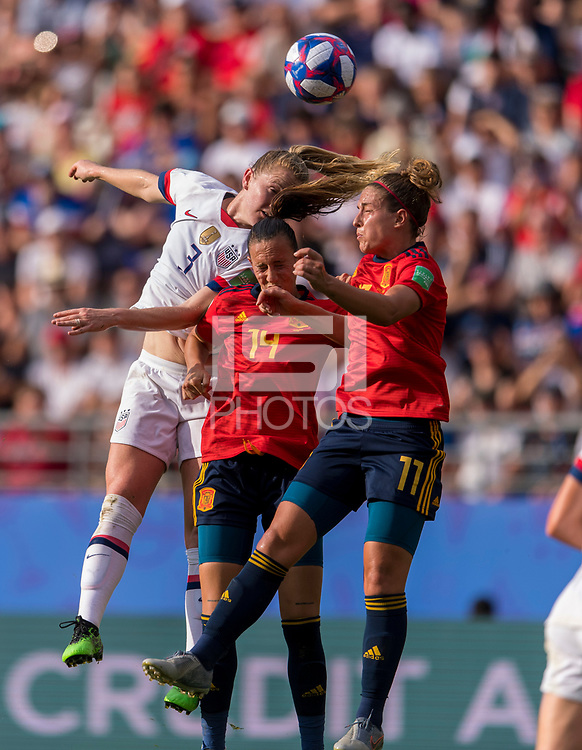 REIMS,  - JUNE 24: Sam Mewis #3 goes up for a header with Virginia Torrecilla #14 and Alexia Putellas #11 during a game between NT v Spain and  at Stade Auguste Delaune on June 24, 2019 in Reims, France.
