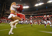 Aug 25, 2007; Glendale, AZ, USA; An Arizona Cardinals cheerleader cheers as the team takes the field against the San Diego Chargers at University of Phoenix Stadium. San Diego defeated Arizona 33-31. Mandatory Credit: Mark J. Rebilas-US PRESSWIRE