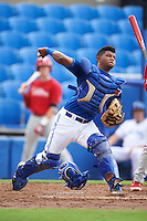GCL Blue Jays catcher Manuel Herazo (9) throws to first during the first game of a doubleheader against the GCL Phillies on August 15, 2016 at Florida Auto Exchange Stadium in Dunedin, Florida.  GCL Phillies defeated the GCL Blue Jays 7-5 in a continuation of a game originally started on July 30th.  (Mike Janes/Four Seam Images)