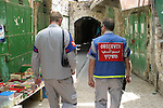 Member of International Presence in Hebron (TIPH) walk on a street in the West Bank city of Hebron on June 13, 2009. TIPH is a civilian observer mission stationed in the West Bank city of Hebron. It is an organization that was called for by the Israeli government and the Palestinian authority in 1997 to support them in their efforts to improve the situation in Hebron. Photo\Najeh Hashlamoun