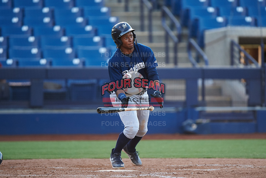 AZL Brewers Blue Orveo Saint (30) hits a double to right field during an Arizona League game against the AZL Brewers Gold on July 13, 2019 at American Family Fields of Phoenix in Phoenix, Arizona. The AZL Brewers Blue defeated the AZL Brewers Gold 6-0. (Zachary Lucy/Four Seam Images)