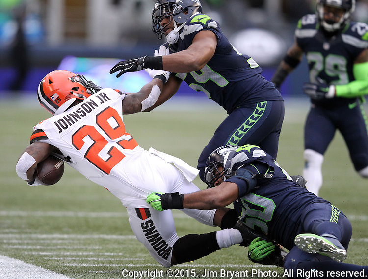 Seattle Seahawks linebackers K.J. Wright (50) and Bobby Wagner (54) brings down Cleveland Browns running back Duke Johnson (29) at CenturyLink Field in Seattle, Washington on December 20, 2015. The Seahawks clinched their fourth straight playoff berth in four seasons by beating the Browns 30-13.  ©2015. Jim Bryant Photo. All Rights Reserved.