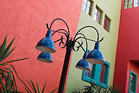 Blue lamp post and brightly colored walls in La Placitas Village.