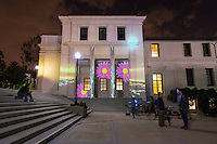 Fowler Hall piece by Marin Weiskopf '17, Zoe Vandervelden '18, Raouf Mostafa.<br /> Students in professor Allison de Fren's class, ArtM260, Exploring Virtual Reality, transform the AGC and Johnson-Fowler Hall area and the Gilman Fountain through projection mapping on Thursday, Nov. 20, 2014. Sometimes called spatial augmented reality, projection mapping is a technique for turning objects and buildings into display surfaces for video projection. Ambient music by KOXY. The event was the culmination of a projection mapping assignment for ArtM260, which is a new course developed through the faculty fellowship program with the CDLA (Center for Digital Liberal Arts) with assistance from Mellon postdoctoral fellow Patty Ahn. Students also received projection mapping workshops and guidance from Evan Weitz of the Mapjacks, an LA-based projection mapping collective. (Photo by Marc Campos, Occidental College Photographer)