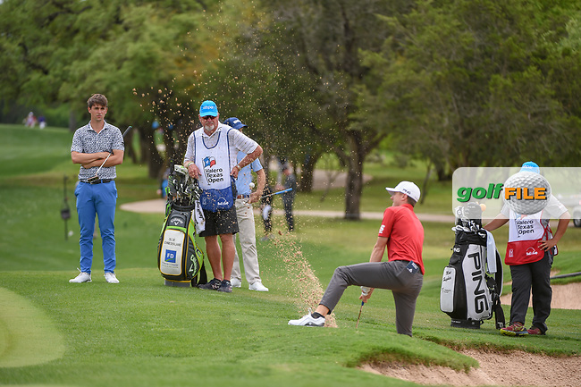 Mackenzie Hughes (CAN) hits with one foot out of the trap on 8 during day 4 of the Valero Texas Open, at the TPC San Antonio Oaks Course, San Antonio, Texas, USA. 4/7/2019.<br /> Picture: Golffile | Ken Murray<br /> <br /> <br /> All photo usage must carry mandatory copyright credit (© Golffile | Ken Murray)