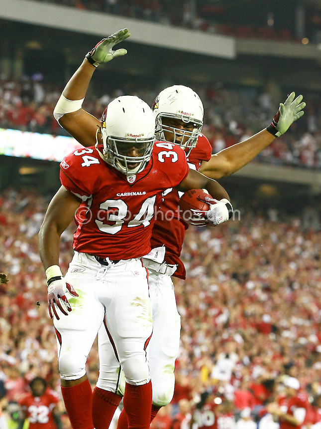 Jan 03, 2009; Glendale, AZ, USA; Arizona Cardinals running back Tim Hightower (34) and another Cardinals player celebrate a touchdown in the third quarter of the NFC Wild Card Playoff Game against the Atlanta Falcons at University of Phoenix Stadium.  The Cardinals won the game 30-24.