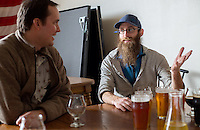 NWA Democrat-Gazette/JASON IVESTER --03/12/2015--<br /> Andy Coates, one of the owners of Ozark Beer Company; talks with Chef Matt McClure of The Hive restaurant on Thursday, March 12, 2015, inside the Rogers brewery