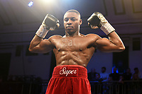 Dan Azeez (red shorts) defeats Edgars Sniedze during a Boxing Show at York Hall on 9th November 2019
