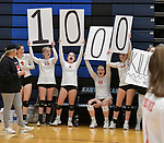 Ursuline Academy teammates hold up posters to recognize player Anna Bair reaching the 1000th kill mark during their game against O'Fallon. The teams competed in the 21st Annual Metro Classic Volleyball Tournament at Belleville East High School on Saturday September 29, 2018. Tim Vizer/Special to STLhighschoolsports.com