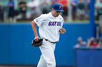 Florida Gators starting pitcher Alex Faedo (21) jogs off the field between innings of the game against the Wake Forest Demon Deacons in Game One of the Gainesville Super Regional of the 2017 College World Series at Alfred McKethan Stadium at Perry Field on June 10, 2017 in Gainesville, Florida.  The Gators defeated the Demon Deacons 2-1 in 11 innings.  (Brian Westerholt/Four Seam Images)