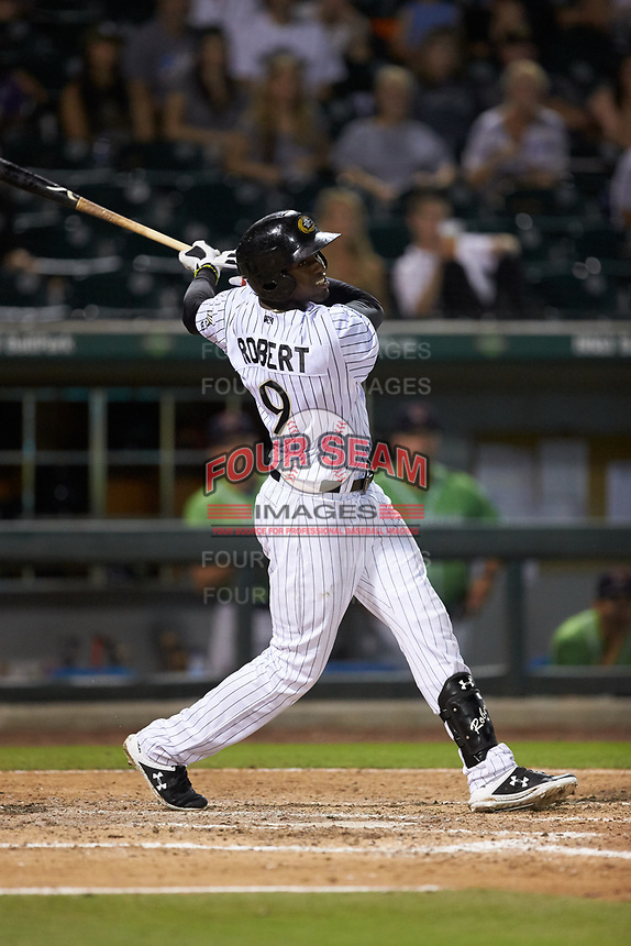 Luis Robert (9) of the Charlotte Knights follows through on his swing against the Gwinnett Braves at BB&T BallPark on July 12, 2019 in Charlotte, North Carolina. The Stripers defeated the Knights 9-3. (Brian Westerholt/Four Seam Images)