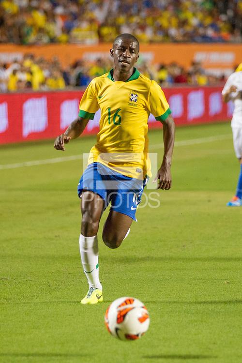 Miami, FL - Saturday, Nov 16, 2013: Brazil vs Honduras during an international friendly at Miami's Sun Life Stadium. Brazil midfielder Ramirez chases down a pass.