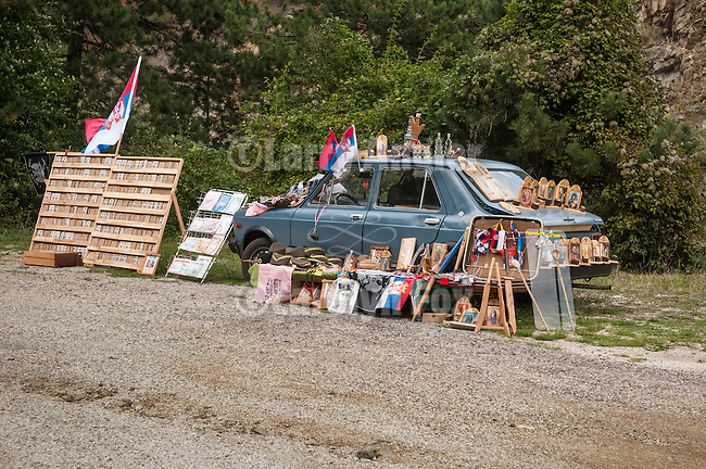 Road-side vendor with blue car along the highway near Mokra Gora, Serbia.