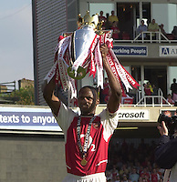 Photo. © Peter Spurrier/Intersport Images.15/05/2004  - 2003/04 Premiership Football - Arsenal v Leicester City:.Patrick Vieira hold the trophy aloft.[Credit] Peter Spurrier Intersport Images