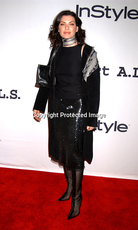..Julianna Margulies in Chaiken coat and Narciso Rodriguez ..skirt..at the 6th Annual New York City Gala to benefit Project ALS on October 20, 2003 at the Hammerstein Ballroom ...Photo by Robin Platzer, Twin Images