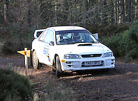 Mark McCulloch - James Haugh in a Subaru Impreza competing at Junction 6 on the Munro Scotch Beef Millbuie Special Stage 1 on the 2014 Arnold Clark/Thistle Hotel Snowman Rally, supported by Highland Office Equipment, part of Capital Document Solutions which was organised by Highland Car Club and based in Inverness on 22.2.14; Round 1 of the 2014 RAC MSA Scottish Rally Championship sponsored by ARR Craib Transport Limited.