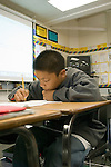 Union City CA 8th grade student working on composition in class