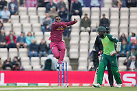 Sheldon Cottrell (West Indies) prepares to bowl as Hashim Amla  (South Africa) backs up during South Africa vs West Indies, ICC World Cup Cricket at the Hampshire Bowl on 10th June 2019