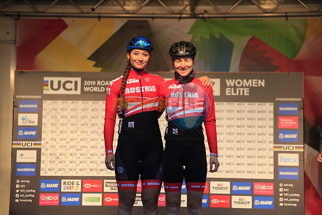 Kathrin Schweinberger and Angelika Tazreiter of Austria at  sign on for the start of the Women Elite Road Race of the UCI World Championships 2019 running 149.4km from Bradford to Harrogate, England. 28th September 2019.<br /> Picture: Eoin Clarke | Cyclefile<br /> <br /> All photos usage must carry mandatory copyright credit (© Cyclefile | Eoin Clarke)