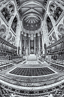 A view of the beautiful altar, chancel, and choir seating area inside the massive Cathedral of Saint John the Divine.  The cathedral is located in Morningside Heights on the west side of Manhattan in New York City.