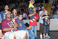 "David Lopez, 32, of Springfield, Mass., (center in red) holds his son David Lopez, Jr., 7, during a WWE Live Summerslam Heatwave Tour event at the MassMutual Center in Springfield, Massachusetts, USA, on Mon., Aug. 14, 2017. David Lopez, Jr., wore a mask similar to those worn by WWE superstar Sin Cara, who wears Lucha Libre-style masks. David Lopez (the father) said it was his son's first wrestling match. ""I remember my dad doing this [with me],"" he said."