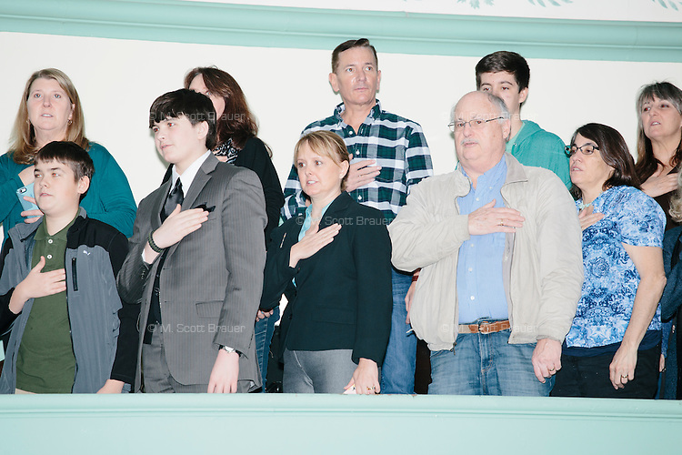 People say the Pledge of Allegiance before real estate mogul and Republican presidential candidate Donald Trump speaks at a rally at Exeter Town Hall in Exeter, New Hampshire, on Thurs., Feb. 4, 2016.