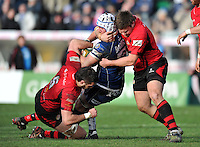 Nick Koster is double-tackled by Dave Markham and Dave Young. Greene King IPA Championship match, between Bristol Rugby and Jersey on February 2, 2014 at the Memorial Stadium in Bristol, England. Photo by: Patrick Khachfe / JMP