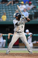 Dayton Dragons designated hitter Jamodrick McGruder (4) at bat during a game against the South Bend Silver Hawks on August 20, 2014 at Four Winds Field in South Bend, Indiana.  Dayton defeated South Bend 5-3.  (Mike Janes/Four Seam Images)