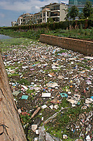 An open canal is polluted with rubblish in Kunming, China. The Yunnan Environmental Protection Bureau has announced that Kunming will be the host city for the China Environmental Protection and Renewable Energy Exposition on raising public awareness about environmental protection..26 Jun 2007