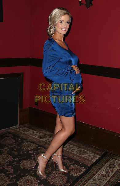 "Holly Madison.House of Blues Foundation Room ""Happy Anniversary Hour""  benefiting the Animal Foundation  at Mandalay Bay Resort Hotel and Casino, Las Vegas, Nevada, USA, 1st December 2012..full length  blue shiny dress pregnant  long sleeve side shoes beige .CAP/ADM/MJT.© MJT/AdMedia/Capital Pictures."