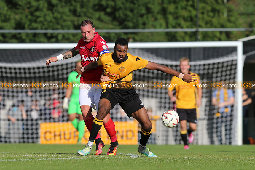 Merstham's Mark Okoye tangles with Ebbsfleet's Danny Kedwell during Merstham vs Ebbsfleet United, Emirates FA Cup Football at Weldon Way on 15th October 2016