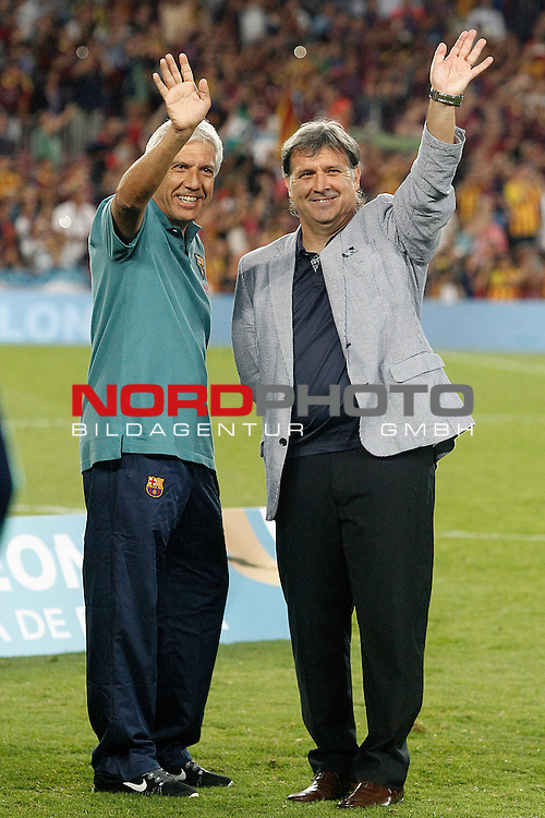 FC Barcelona's coach Gerardo Tata Martino (r) and the Physical trainer Elvio Paulorosso celebrate the victory in the Supercup of Spain.August 28,2013. Foto © nph / Acero)