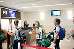 Soccer players from Wright State wait in line to board a flight to Los Angeles at Gate F8 at the Maynard H. Jackson Jr. International Terminal at Hartsfield–Jackson Atlanta International Airport, in Atlanta, Georgia on August 28, 2013.