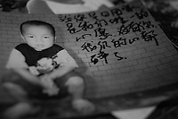 "Picture of a little boy, Li Yuan Hu, 4 years old, lost in GuanDu district in Kumming city on 25 November 2004. Message written by Mrs Li reads ""Our only wish is to see you come home as soon as possible. Our hearts are broken without you.""..PHOTO BY SINOPIX"