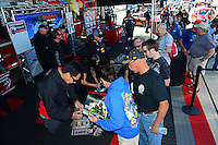 Oct. 26, 2012; Las Vegas, NV, USA: NHRA funny car driver Cruz Pedregon signs autographs during qualifying for the Big O Tires Nationals at The Strip in Las Vegas. Mandatory Credit: Mark J. Rebilas-