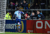 Scott Kashket of Wycombe Wanderers celebrates his goal with some young supporters during the The Checkatrade Trophy Southern Group D match between Wycombe Wanderers and Coventry City at Adams Park, High Wycombe, England on 9 November 2016. Photo by Andy Rowland.