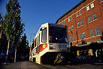 Light Rail train at sunrise downtown Oldtown District Portland Oregon State USA