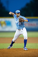 Burlington Royals relief pitcher Chase Darhower (28) makes a pick-off throw to first base against the Pulaski Yankees at Burlington Athletic Park on August 6, 2015 in Burlington, North Carolina.  The Royals defeated the Yankees 1-0. (Brian Westerholt/Four Seam Images)
